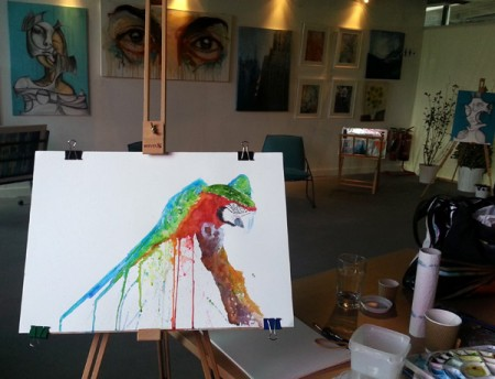 macaw painting demo in Camden Stables Market